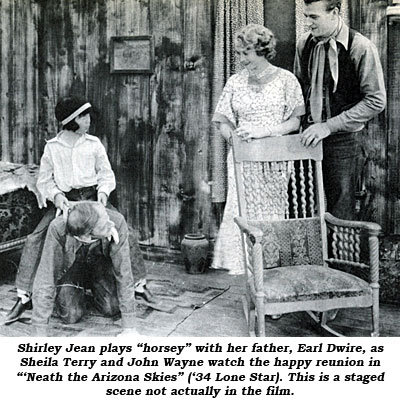 "Shirley Jean plays ""horsey"" with her father, Earl Dwire, as Sheila Terry and John Wayne watch the happy reunion in ""'Neath the Arizona Skies"" ('34 Lone Star). This is a staged scene not actually in the film."
