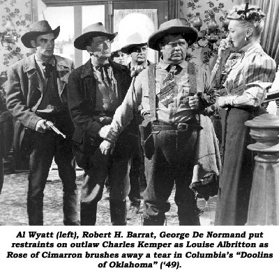 "Al Waytt (left), Robert H. Barrat, George De Normand put restraints on outlaw Charles Kemper as Louise Albritton as Rose of Cimarron brushes away a tear in Columbia's ""Doolins of Oklahoma""."