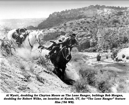 "Al Wyatt, doubling for Clayton Moore as The Lone Ranger, bulldogs Bob Morgan, doubling for Robert Wilke, on location at Kanab, UT, for ""The Lone Ranger"" feature film ('56 WB)."