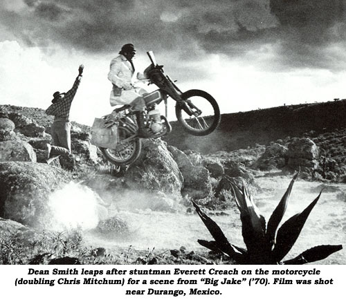 "Dean Smith leaps after stuntman Everett Creach on the motorcycle (doubling Chris Mitchum) for a scene from ""Big Jake"" ('70). Film was shot near Durango, Mexico."