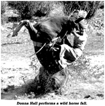 Donna Hall performs a wild horse fall.