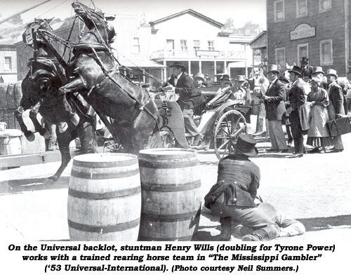 "On the Universal backlot, stuntman Henry Wills (doubling for Tyrone Power) works with a trained rearing horse team in ""The Mississippi Gambler"" ('53 Universal-International). (Photo courtesy Neil Summers.)"