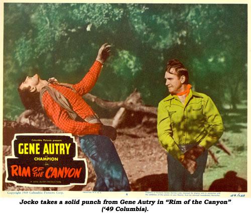 "Jocko takes a solid punch from Gene Autry in ""Rim of the Canyon"" ('49 Columbia)."