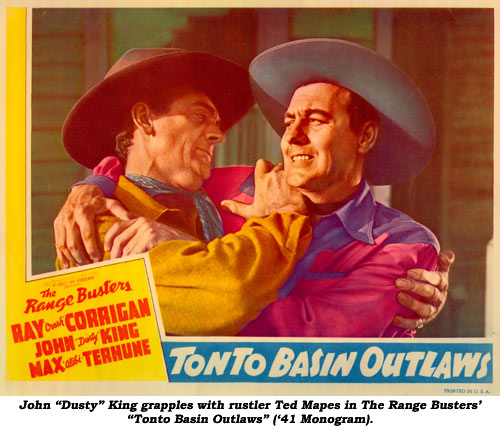 "John ""Dusty"" King grapples with rustler Ted Mapes in The Range Busters' ""Tonto Basin Outlaws"" ('41 Monogram)."