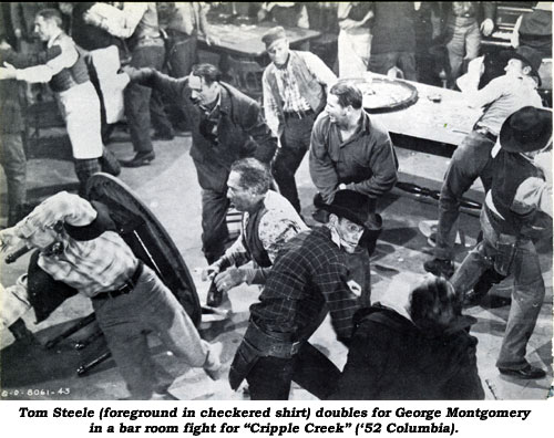 "Tom Steele (foreground in checkered shirt) doubles for George Montgomery in a bar room fight for ""Cripple Creek"" ('52 Columbia)."
