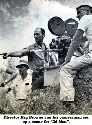 "Director Reg Browne and his cameraman set up a scene for ""26 Men""."