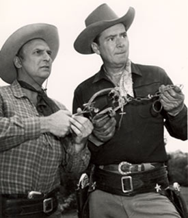"Jackie Coogan and Russell Hayden in ""Cowboy G-Men""."
