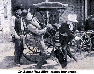 Dr. Baxter (Rex Allen) swings into action.