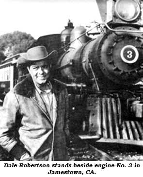 Dale Robertson stands beside engine No. 3 in Jamestown, CA.