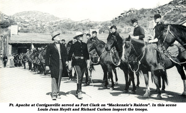"Ft. Apache at Corriganville served as Fort Clark on ""Mackenzie's Raiders"". In this scene Louis Jean Heydt and Richard Carlson inspect the troops."