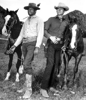 Don Murray and Otis Young with their horses.