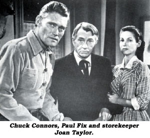 Chuck Connors, Paul Fix and storekeeper Joan Taylor.