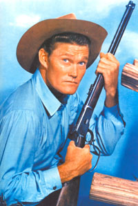 "Chuck Connors as ""The Rifleman""."