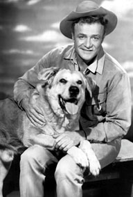 Brian Keith as Dave Blassingame with his dog Brown (Spike).