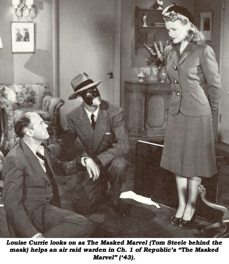 "Louise Currie looks on as The Masked Marvel (Tom Steele behind the mask) helps an air raid warden in Ch. 1 of Republic's ""The Masked Marvel"" ('43)."