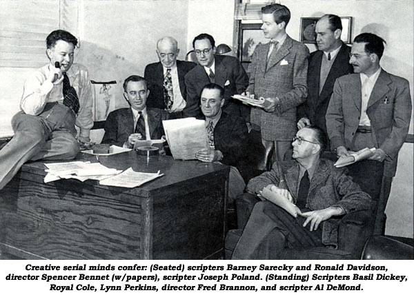 Creative serial minds confer: (seated) scripters Barney Sarecky and Ronald Davidson, director Spencer Bennet (w/papers), scripter Joseph Poland. (Standing) Scripters Basil Dickey, Royal Cole, Lynn Perkins, director Fred Brannon, and scripter Al DeMond.