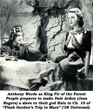 "Anthony Warde as King Fir of the Forest People prepares to make Dale Arden (Jean Rogers) a slave to their god Kalu in Ch. 10 of ""Flash Gordon's Trip to Mars"" ('38 Universal)."