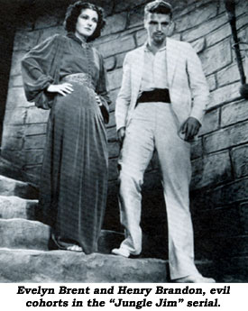 "Evelyn Brent and Henry Brandon, evil co-horts in the ""Jungle Jim"" serial."