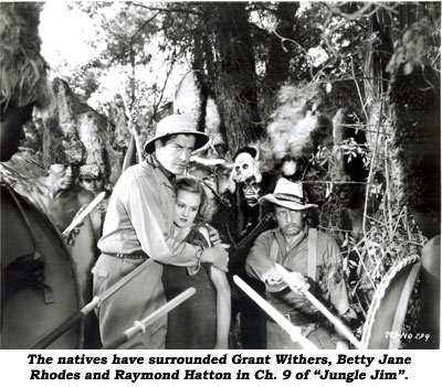 "The natives have surrounded Grant Withers, Betty Jane Rhodes and Raymond Hatton in Ch. 9 of ""Jungle Jim""."