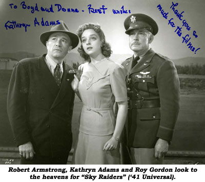 "Robert Armstrong, Kathryn Adams and Roy Gordon look to the heavens for ""Sky Raiders"" ('41 Universal)."