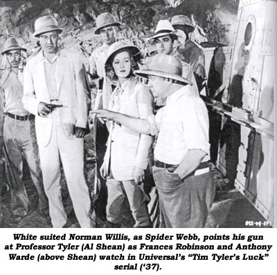 "White suited Norman Willis, as Spider Webb, points his gun at Professor Tyler (Al Shean) as Frances Robinson and Anthony Warde (above Shean) watch in Universal's ""Tim Tyler's Luck"" serial ('37)."