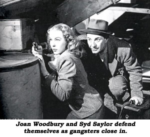Joan Woodbury and Syd Saylor defend themselves as gangsters close in.