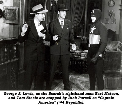 "George J. Lewis, as the Scarab's righthand man Bart Matson, and Tom Steele are stopped by Dick Purcell as ""Captain America"" ('44 Republic)."