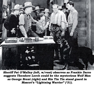 "Sheriff Pat O'Malley (left, w/vest) observes as Frankie Darro suggests Theodore Lorch could be the mysterious Wolf Man as George Brent (right) and Rin Tin Tin stand guard in Mascot's ""Lightning Warrior"" ('31)."