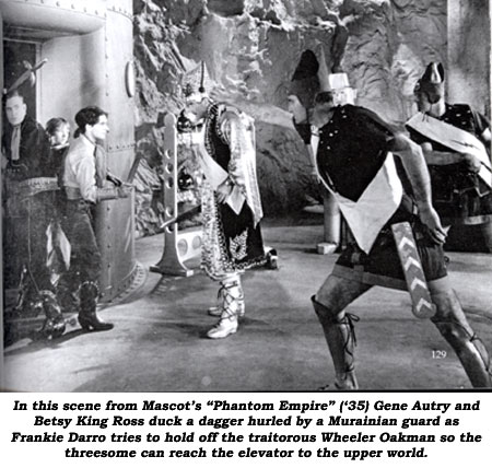 "In this scene from Mascot's ""Phantom Empire"" ('35) Gene Autry and Betsy King Ross duck a dagger hurled by a Murainian guard as Frankie Darro tries to hold off the traitorous Wheeler Oakman so the threesome can reach the elevator to the upper world."