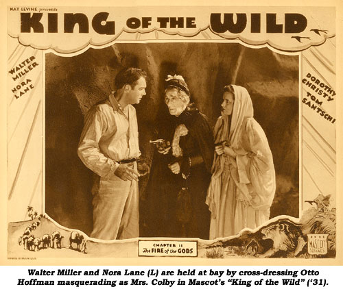 "Walter Miller and Nora Lane (L) are held at bay by cross-dressing Otto Hoffman masquerading as Mrs. Colby in Mascot's ""King of the Wild"" ('31)."