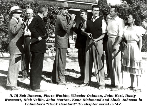 "(L-R) Bob Duncan, Pierre Watkin, Wheeler Oakman, John Hart, Rusty Wescoatt, Rick Vallin, John Merton, Kane Richmond and Linda Johnson in Columbia's ""Brick Bradford"" 15 chapter serial in '47."