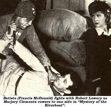 "Batiste (Francis McDonald) fights with Robert Lowery as Marjory Clements cowers to one side in ""Mystery of the Riverboat""."
