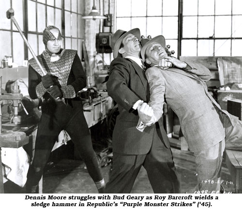"Dennis Moore struggles with Bud Geary as Roy Barcroft wields a sledge hammer in Republic's ""Purple Monster Strikes"" ('45)."