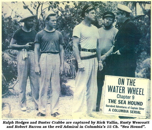 "Ralph Hodges and Buster Crabbe are captured by Rick Vallin, Rusty Wescoatt and Robert Barron as the evil Admiral in Columbia's 15 Ch. ""Sea Hound""."