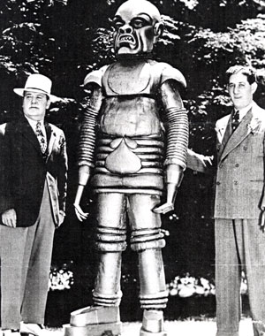 "The eight ft. robot from Universal's ""The Phantom Creeps"" ('37) stands beside producer Henry MacRae (left) and director Saul Goodkind."