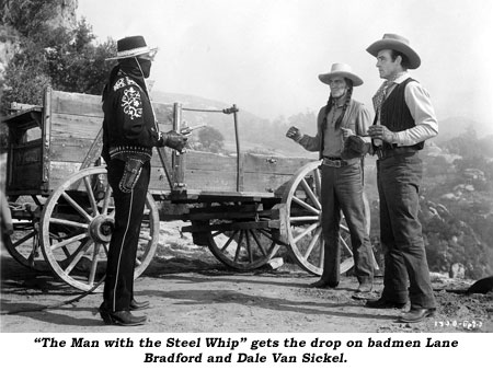 """The Man with the Steel Whip"" gets the drop on badmen Lane Bradford and Dale Van Sickel."