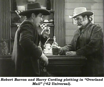 "Robert Barron and Harry Cording plotting in ""Overland Mail"" ('42 Universal)."