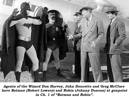"Agents of the Wizard Don Harvey, John Doucette and Greg McClure have Batman (Robert Lowery) and Robin (Johnny Duncan) at gun point in Ch. 1 of ""Batman and Robin""."