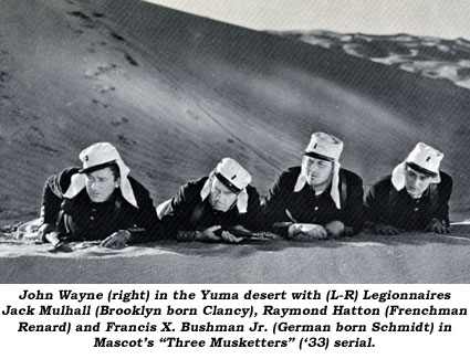 "John Wayne (right) in the Yuma desert with (L-R) Legionnnaires Jack Mulhall (Brooklyn born Clancy), Raymond Hatton (Frenchman Renard) and Francis X. Bushman Jr. (German born Schmidt) in Mascot's ""Three Musketeers"" ('33) serial."
