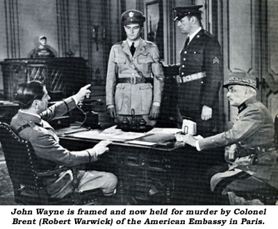 John Wayne is framed and now held for murder by Colonel Brent (Robert Warwick) of the American Embassy in Paris.