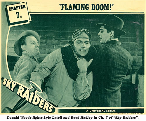 "Donald Woods fights Lyle Latell and Reed Hadley in Ch. 7 of ""Sly Raiders""."