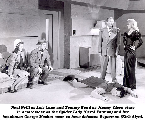 Noel Neill as Lois Lane and Tommy Bond as Jimmy Olsen stare in amazement as the Spider Lady (Carol Forman) and her henchman George Meeker seem to have defeated Superman (Kirk Alyn).