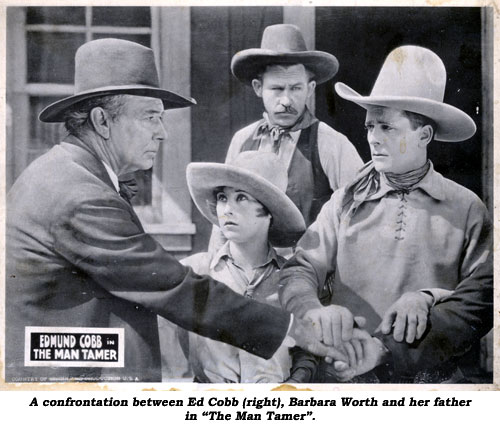 "A confrontation between Ed Cobb (right), Barbara Worth and her father in ""The Man Tamer""."