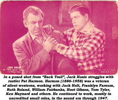 "Jack Hoxie and Pat Harmon in a posed shot from ""Back Trail""."