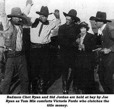 Badmen Chet Ryan and Sid Jordan are held at bay by Joe Ryan as Tom Mix comforts Victoria Forde who clutches the title money.