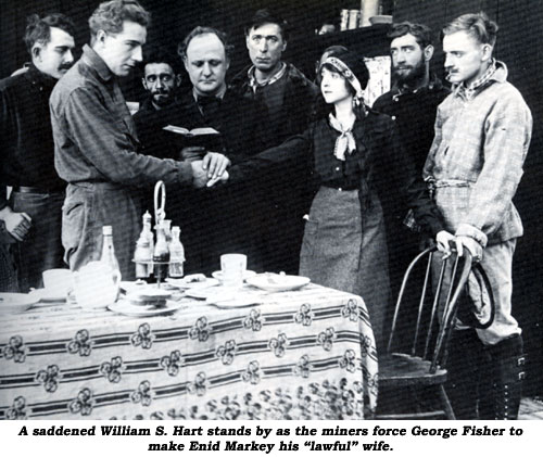 "A saddened William S. Hart stands by as the miners force George Fisher to make Enid Markey his ""lawful"" wife."