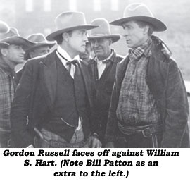Gordon Russell faces off against William S. Hart. (Note Bill Patton as an extra to the left.)