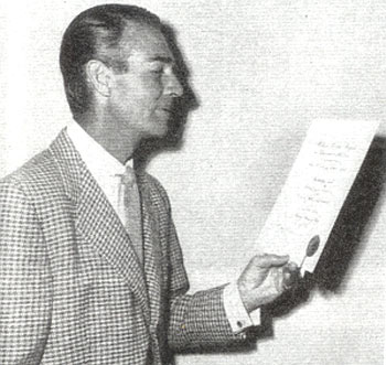 Randolph Scott checks his 1951 award from The Motion Picture Exhibitors of America. Scott was ranked as one of the Top 10 Western Stars that year. More award photos from 1950, 1951 and 1952 will be in WESTERN CLIPPINGS #85 (Sept./Oct. '08).