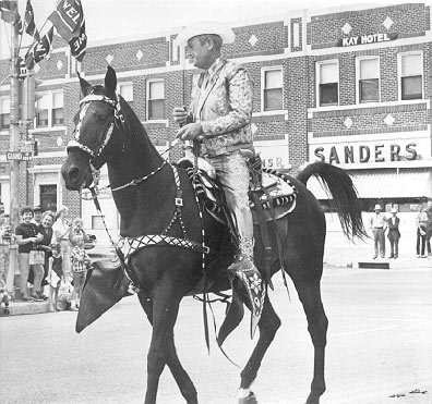 Rex Allen rides in the 101 Ranch Parade in Ponca City, Oklahoma, in 1966
