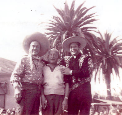 Leo Carrillo as Pancho, comic Vince Barnett, and Duncan Renaldo (The Cisco Kid) pose in 1954 at St. Catherine's Military Academy in Anaheim, CA.